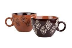 有样式的两个棕色杯子 图库摄影
