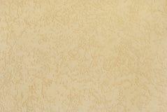 有样式的淡黄的涂灰泥的墙壁 库存图片