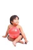 有桃红色健身球的男孩在白色背景 免版税库存照片