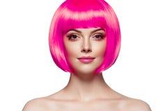 有桃红色在白色隔绝的头发美好的femail模型的妇女 库存照片