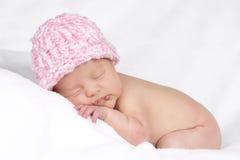 有桃红色帽子的婴孩 库存图片