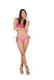 有桃红色游泳衣认为的可爱的妇女 库存照片