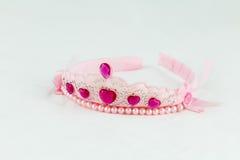 有桃红色珠宝的桃红色冠 图库摄影