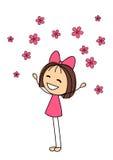 有桃红色花的逗人喜爱的小女孩 免版税库存照片