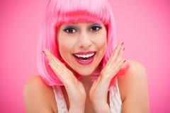 有桃红色头发的逗人喜爱的女孩 图库摄影