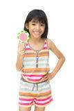 有棒棒糖的亚裔女孩 免版税库存照片