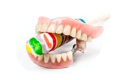 有棒棒糖的假牙 免版税库存图片
