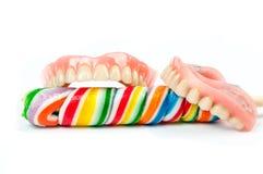 有棒棒糖的假牙 库存照片