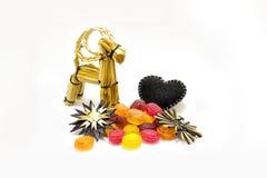 有棒棒糖的圣诞节玩具 免版税库存图片
