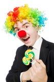 有棒棒糖的小丑 库存照片