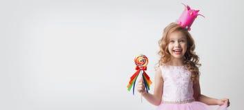 有棒棒糖的糖果公主 免版税图库摄影