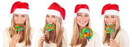 有棒棒糖的逗人喜爱的圣诞老人女孩 库存图片