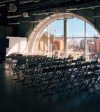 有椅子和大窗口的观众席 库存照片