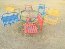 有椅子的旋转木马 库存照片