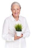 有植物的老婆婆 免版税库存图片