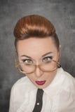 有横渡的眼睛的疯狂的老师 免版税库存照片