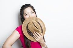 有横渡的胳膊的微笑的亚裔女孩 库存图片