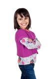 有横渡的胳膊的快乐的女孩 免版税库存图片