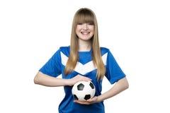有橄榄球的女孩 图库摄影