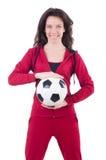 有橄榄球的少妇 免版税库存照片
