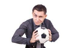 有橄榄球的滑稽的人 库存图片