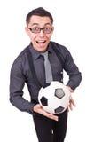 有橄榄球的滑稽的人 库存照片