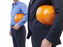 有橙色安全帽子的人 免版税库存图片