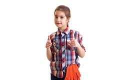 有橙色手套的小女孩 库存图片