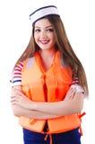 有橙色背心的妇女 库存照片