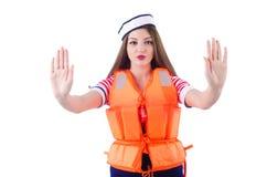 有橙色背心的妇女 免版税库存图片