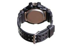 有橡胶镯子体育的黑手表 库存照片