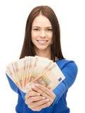 有欧洲现金金钱的可爱的妇女 免版税库存图片