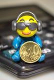 有欧洲硬币的彩色塑泥人 免版税库存图片