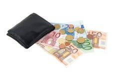 有欧洲纸币和硬币的钱包 免版税图库摄影