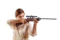 有步枪的夫人 免版税库存照片