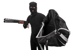 有步枪的窃贼拿着袋子和请求金钱 库存图片