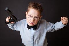 有武器的一个小男孩 库存图片
