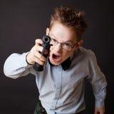 有武器的一个小男孩 免版税库存照片