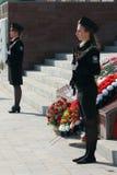 有武器的两个女孩军校学生 免版税库存照片