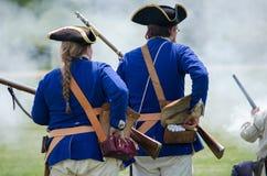 有武器的早期的美军士兵 免版税库存照片