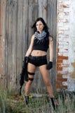 有武器的美丽的女孩 图库摄影