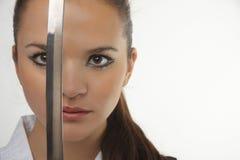 有武士剑的可爱的年轻性感的妇女 免版税图库摄影