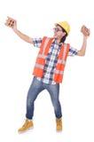 有残破的砖的滑稽的年轻建筑工人 免版税库存照片