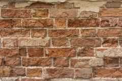 有残破的砖纹理的困厄的墙壁 免版税库存图片