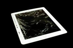 有残破的玻璃屏幕的片剂计算机 免版税库存照片