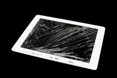 有残破的玻璃屏幕的片剂计算机 库存图片