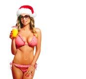 有比基尼泳装的圣诞老人妇女 库存照片