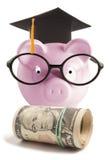 有毕业帽子的存钱罐 库存图片