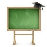 有毕业盖帽的学校黑板 库存图片