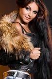 有毛皮的时髦的女人 免版税图库摄影